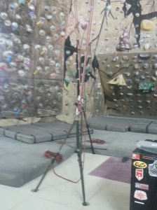 The belayer controls the rope of the climber using the belay device
